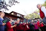Joyous seasonal melodies by the Schola Cantorum chorus, above, welcome visitors to the Holiday Celebration at the J. Gilbert Smith House Nov. 14.  Music Director, Gary Wait, above, directs the group as they sing carols for the courtyard audience.