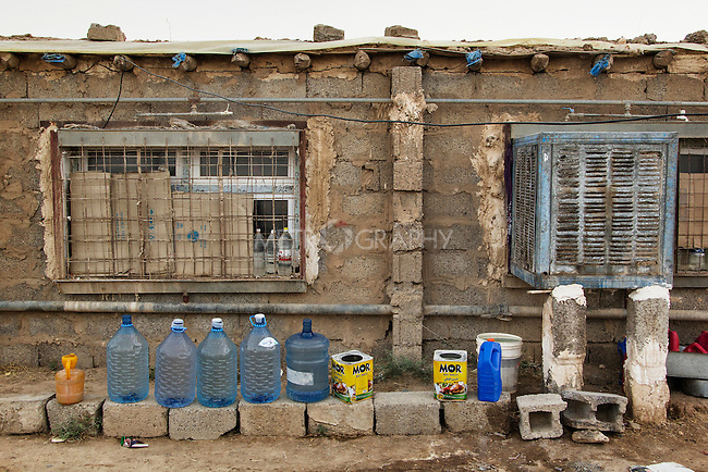 04/07/2015 -- Dibaga-Makhmur-, Iraq -- Displaced people from Jarallah village keep bottles of water in front of their houses to take shower with.