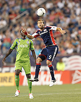 New England Revolution defender AJ Soares (5) heads the ball. In a Major League Soccer (MLS) match, the New England Revolution tied the Seattle Sounders FC, 2-2, at Gillette Stadium on June 30, 2012.