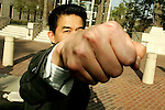 April 29, 2009 Santa Ana, CA   Danny Pang, founder and ex-chief executive officer of Private Equity Management Group Inc., try to block a photographer as he departs federal court in Santa Ana, California, U.S., on Wednesday, April 29, 2009.   Pang, who U.S. regulators say defrauded investors in Taiwan, was ordered freed on $1 million bail.