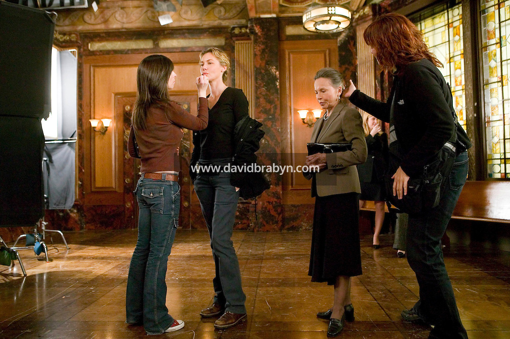 """8 May 2006 - North Bergen, NJ - Actresses Leslie Caron (2R) and Connie Nielsen (2L) get hair and makeup retouches between takes on the studio set of television show """"Law & Order: SVU"""" in North Bergen, USA, 8 May 2006. In this rare appearance in front of American television cameras, Caron, 74, plays a French victim of past sexual molestation in an episode entitled """"Recall"""" due to air in the fall. Caron starred in Hollywood classics such as """"An American in Paris"""" (1951), """"Lili"""" (1953), """"Gigi"""" (1958). More recently she appeared in """"Chocolat"""" (2000) and """"Le Divorce"""" (2003). Photo Credit: David Brabyn"""