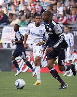 San Jose Earthquakes forward Ryan Johnson (19) and New England Revolution defender Cory Gibbs (12) compete for the ball near the Revolution's goal.  The New England Revolution and San Jose Earthquakes play to a scoreless draw at Gillette Stadium on May 15, 2010