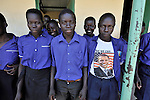 Students--one with a shirt sporting Barack Obama--outside their classroom in the Southern Sudanese village of Kenyi. The school was constructed by the United Methodist Committee on Relief (UMCOR).  Families here are rebuilding their lives after returning from refuge in Uganda in 2006 following the 2005 Comprehensive Peace Agreement between the north and south. NOTE: In July 2011, Southern Sudan became the independent country of South Sudan