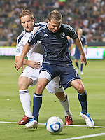 CARSON, CA – May 14, 2011: Sporting KC midfielder Michael Harrington shields LA Galaxy midfielder Chris Birchall (8) from the ball during the match between LA Galaxy and Sporting Kansas City at the Home Depot Center in Carson, California. Final score LA Galaxy 4, Sporting Kansas City 1.