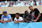 12 September 2015: UNC basketball players watch the game. From left: Marcus Paige, Joel Berry II, Theo Pinson, and Brice Johnson. The University of North Carolina Tar Heels hosted the North Carolina A&T State University Aggies at Kenan Memorial Stadium in Chapel Hill, North Carolina in a 2015 NCAA Division I College Football game.