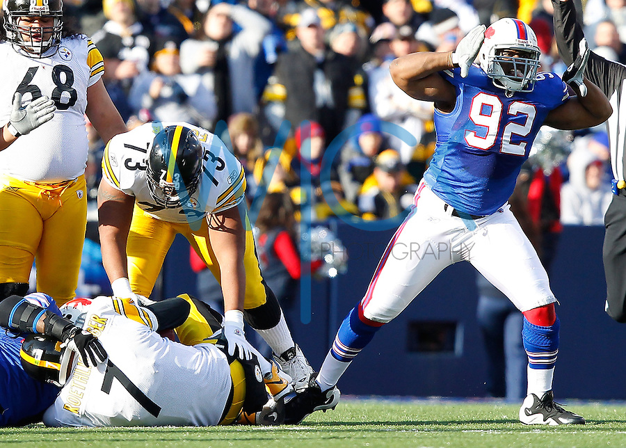 ORCHARD PARK, NY - NOVEMBER 28: Alex Carrington #92 of the Buffalo Bills celebrates after sacking Ben Roethlisberger #7 of the Pittsburgh Steelers during the game on November 28, 2010 at Ralph Wilson Stadium in Orchard Park, New York.  (Photo by Jared Wickerham/Getty Images)