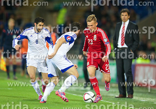 13.10.2014, City Stadium, Cardiff, WAL, UEFA Euro Qualifikation, Wales vs Zypern, Gruppe B, im Bild Wales' George Williams in action against Cyprus // 15054000 during the UEFA EURO 2016 Qualifier group B match between Wales and Cyprus at the City Stadium in Cardiff, Wales on 2014/10/13. EXPA Pictures &copy; 2014, PhotoCredit: EXPA/ Propagandaphoto/ David Rawcliffe<br /> <br /> *****ATTENTION - OUT of ENG, GBR*****
