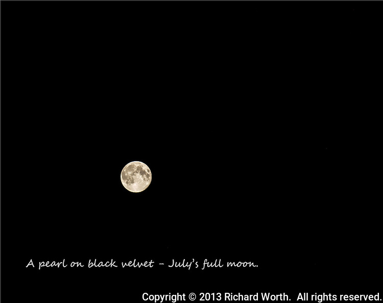 "The full moon against a black sky, no stars, and the caption, ""A pearl on black velvet - July's full moon."""