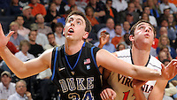 Feb. 16, 2011; Charlottesville, VA, USA; Duke Blue Devils forward Ryan Kelly (34) looks for the loose ball next to Virginia Cavaliers guard Joe Harris (12) during the second half of the game at the John Paul Jones Arena. The Duke Blue Devils won 56-41. ( Credit Image: © Andrew Shurtleff