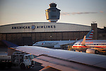 NEW YORK, NY -- AUGUST 13, 2015:  American Airlines Group Inc. jets sit parked outside of a hangar at La Guardia Airport on Thursday, August 13, 2015 in New York City. PHOTOGRAPH BY MICHAEL NAGLE