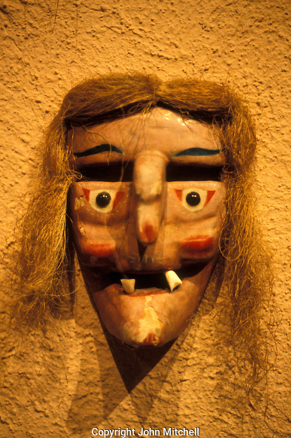 Old Man or Viejito mask from the Mexican state of Michoacan on display in the Museo Rafael Coronel, which is housed in the ruins of the 16th century ex-Convento de San Francisco, city of Zacatecas, Mexico