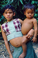 Caboclo (mixed blood rural people) girl carrying baby in the Amazon region, State of Para, Brazil