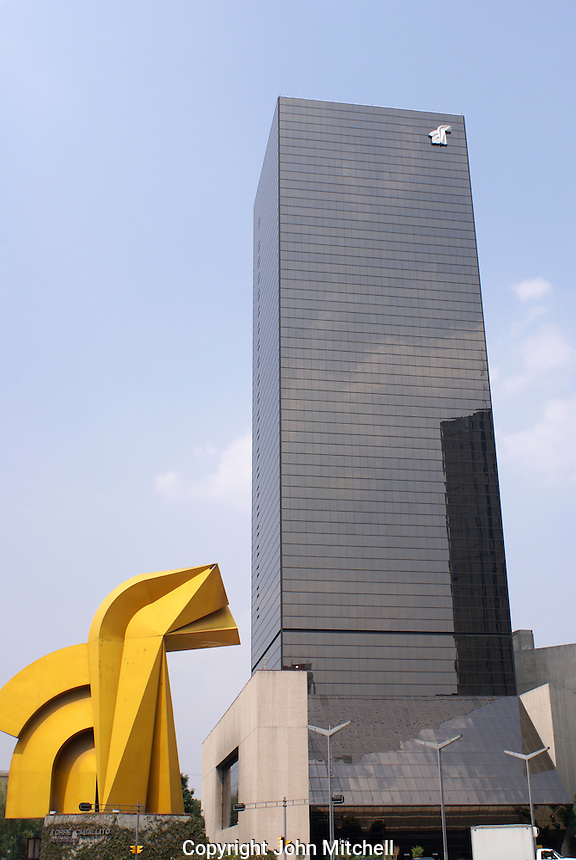 Abstract metal sculpture and office tower on the Paseo de La Reforma  in Mexico City