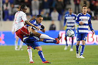 Macoumba Kandji (10) of the New York Red Bulls fouls Daniel Hernandez (2) of FC Dallas as he tries to play the ball. The New York Red Bulls defeated FC Dallas 2-1 during a Major League Soccer (MLS) match at Red Bull Arena in Harrison, NJ, on April 17, 2010.