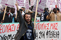 Protest march by immigrants in Athens. 17-3-12 A march by immigrants, refugees and their leftwing supporters in Athens against attacks by racists and far right activists. The protest was called specifically against the recent gains by the neo nazi Goldon Dawn Party who claimed ownership of St Panteleimonas square and the surrounding neighbourhood. The march was prevented from reaching the square by heavily armed riot Police who kept the two sides apart.