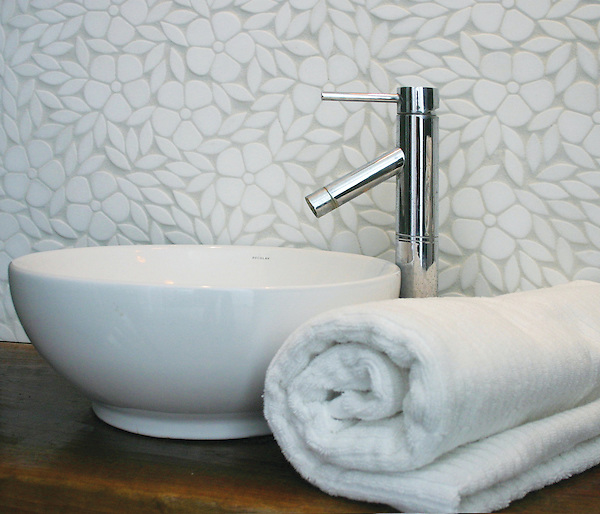 Jacqueline, a natural stone waterjet  floral mosaic, is shown in tumbled Thassos.
