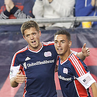 New England Revolution midfielder Diego Fagundez (14) celebrates his goal with New England Revolution midfielder Kelyn Rowe (11). In a Major League Soccer (MLS) match, Montreal Impact (white/blue) defeated the New England Revolution (dark blue), 4-2, at Gillette Stadium on September 8, 2013.