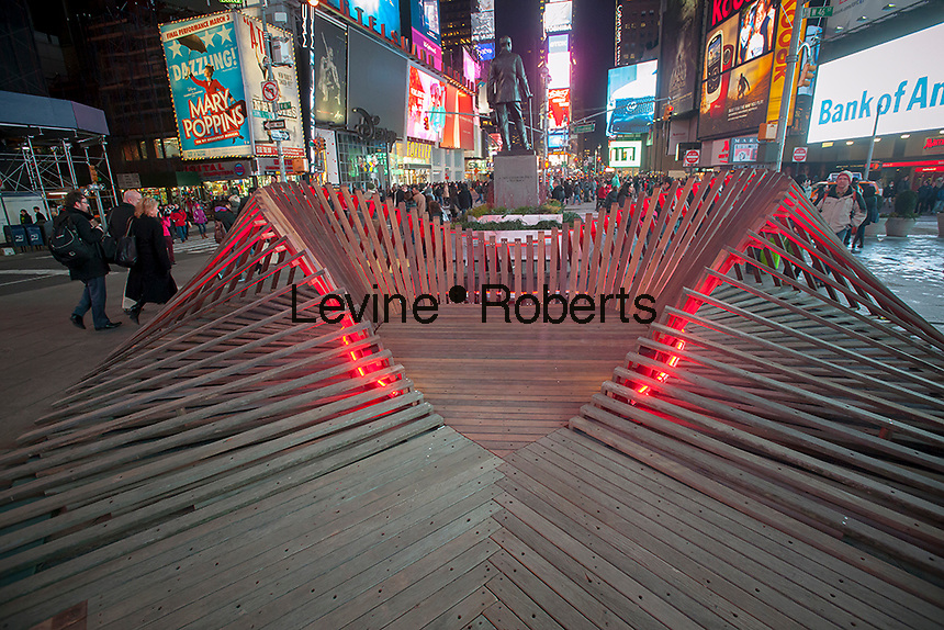"""Heartwalk"" created by the architecture firm Situ Studio on view in Times Square in New York for Valentine's Day, seen on Tuesday, February 12, 2013. The heart-shaped sculpture includes wood salvaged from boardwalks damaged by Hurricane Sandy and by entering the sculpture visitors can stand in the ""heart"" of New York. The sculpture is tied in with the ""Free Love in Times Square"" promotion offering discounts on restaurants, hotels and other entertainment.  (© Richard B. Levin)e"