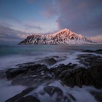 Waves was over tidal rocks at Skagsanden beach, Flakstadøy, Lofoten Islands, Norway