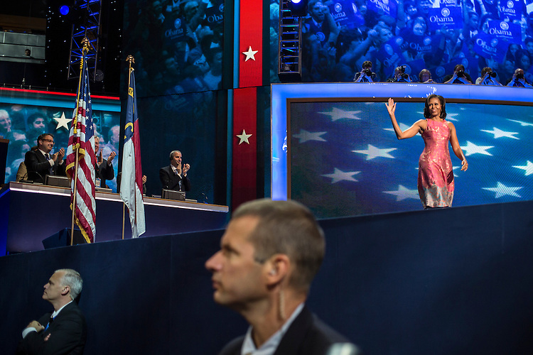 First Lady Michelle Obama walks on stage to speak at the Democratic National Convention on Tuesday, September 4, 2012 in Charlotte, NC.