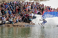 """Cushing Classic at Squaw Valley 24"" - Photograph of a skier crossing a pond during the Cushing Classic at Squaw Valley, USA."