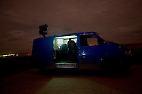 A Frontex van equipped with thermal vision scans the Turkish-Greek border for migrants trying to make an illegal border crossing. The EU border patrol agency is making special efforts to catch the traffickers who accompany the migrants. According to UNHCR, 38,992 immigrants arrived in Greece in the first 10 months of 2010, whereas in 2009 the number was only 7,574. A poster in the window shows prices to travel to Athens. According to Frontex, around 245 people tried to cross the border illegally every night during October.