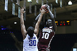 22 March 2015: Mississippi State's Martha Alwal (10) shoots over Duke's Amber Henson (30). The Duke University Blue Devils hosted the Mississippi State University Bulldogs at Cameron Indoor Stadium in Durham, North Carolina in a 2014-15 NCAA Division I Women's Basketball Tournament second round game. Duke won the game 64-56.