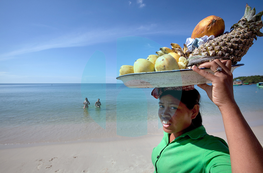 January 7th, 2009_SIHANOUKVILLE, CAMBODIA_ A girl sells fresh fruit to tourists on the beach town of Sihanoukville, which is on Cambodia's southern coast.  Sihanoukville is Cambodia's main sun and surf tourist destination.  Photographer: Daniel J. Groshong/Tayo Photo Group