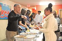 NOV 25 The Obamas Serve Thanksgiving Meals to the Needy