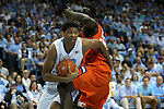 30 December 2015: North Carolina's Isaiah Hicks (left) gets tangled up with Clemson's Sidy Djitte (SEN) (right). The University of North Carolina Tar Heels hosted the Clemson University Tigers at the Dean E. Smith Center in Chapel Hill, North Carolina in a 2015-16 NCAA Division I Men's Basketball game. UNC won the game 80-69.