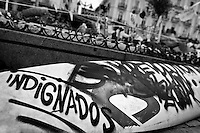 A political message painted on a surf board in the protest camp on Puerta del Sol square, Madrid, Spain, 7 June 2011.
