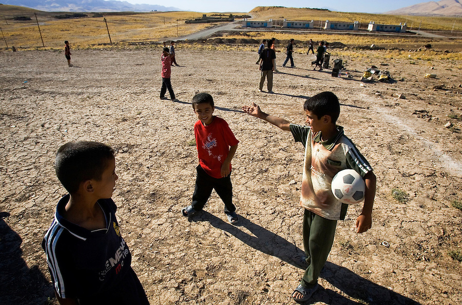Children - descendants of Iranian Kurds who came to Iraq as refugees and settled in the Al-Anbar capital Ramadi - play on a rough soccer field at a refugee camp on the eastern approaches to Suleymaniah, Iraqi Kurdistan on Monday September 19, 2006. The refugees who came to Iraq fleeing persecution in Iran were forced by Saddam Hussein to migrate to Al-Anbar. Following the explosion of violence in western Iraq after the invasion, they were once again forced to flee and have been moving back to Iraqi Kurdistan since 2004.