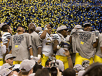 Michigan players celebrate after winning Sugar Bowl game against Virginia Tech at Mercedes-Benz SuperDome in New Orleans, Louisiana on January 3rd, 2012.  Michigan defeated Virginia Tech, 23-20 in first overtime.