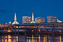 Convention Center, I-5 freeway and Willamette River at dusk, Portland, Oregon.