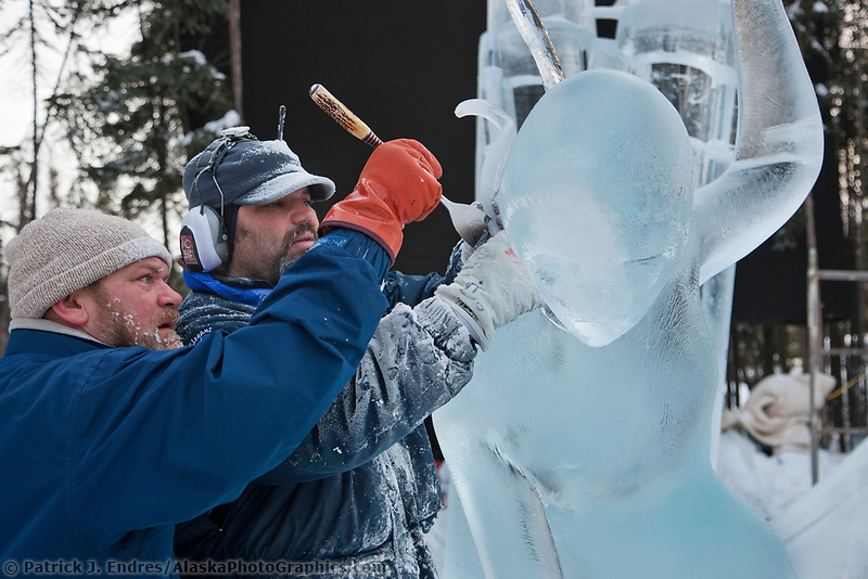 """Ice artists Vladimir Zhikhartsev and Aaron Costic work on """"Pandoras Box"""" a multi-block sculpture that earned first place in the abstract category, 2009 World Ice Art Championships, Fairbanks, Alaska"""