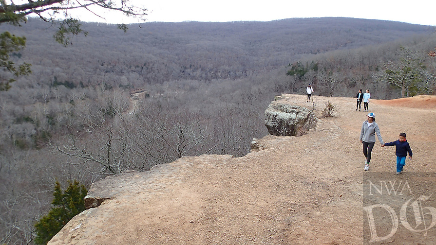 NWA Democrat-Gazette/FLIP PUTTHOFF <br /> Visitors to the overlook along Yellow Rock Trail at Devil's Den State Park can number in the hundreds on weekends when the weather is pleasant. Hikers take in the view Jan. 1 2017 from the overlook.