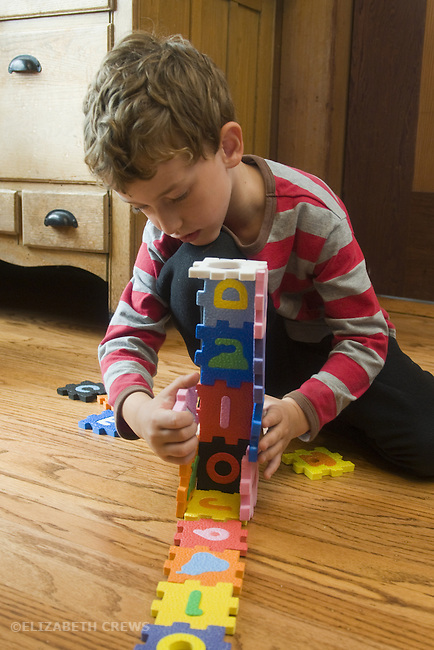 Berkeley CA Boy, five, constructing an object with interlocking blocks  MR