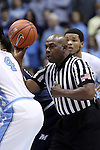 28 December 2016: Referee Les Jones prepares to hoist the opening tipoff. The University of North Carolina Tar Heels hosted the Monmouth University Hawks at the Dean E. Smith Center in Chapel Hill, North Carolina in a 2016-17 NCAA Division I Men's Basketball game. UNC won the game 102-74.