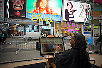 An artist uses a touch screen computer loaded with the new Windows 8 operating system software at a promotional event using hardware from various manufacturers in Times Square in New York on its launch date, Friday, October 26, 2012. Microsoft is billing Windows 8 as the greatest overhaul of its predominant operating system in 20 years. (© Richard B. Levine)