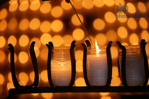 Lighting candles at the Grotto.<br /> <br /> Photo by Matt Cashore/University of Notre Dame