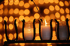 Lighting candles at the Grotto.<br />