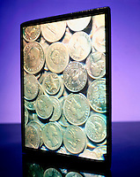 HOLOGRAM OF COINS<br /> A true three dimensional photograph recorded on film by a reflected laser beam of a subject.