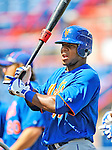 10 March 2012: New York Mets outfielder Cesar Puello awaits his turn in the batting cage prior to a Spring Training game against the Washington Nationals at Space Coast Stadium in Viera, Florida. The Nationals defeated the Mets 8-2 in Grapefruit League play. Mandatory Credit: Ed Wolfstein Photo