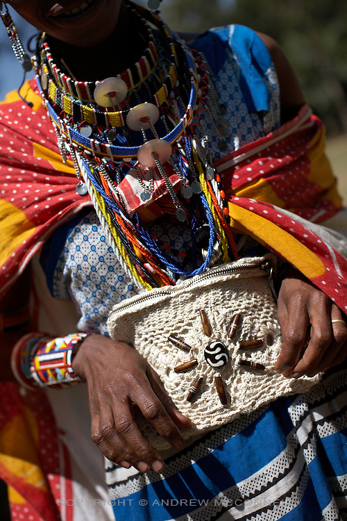 The Zaffiro all-purpose case is held by a Maasai woman, in Nairobi, Kenya, on Thursday, Jan. 15, 2009. The case is an an example of old style crochet work adorned with small bone disks. The Maasai are one of groups who contribute to production of the MAX&Co. range and mainly carry out bead work at which they are specialists.