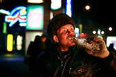 A homeless Russian man drink vodka on a street in Moscow several days after the New Year celebrations. .Alcoholism is one of the main causes of death in Russia.