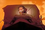 elder patient in hospital bed with oxygen supply, ventilator