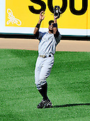 New York Yankees centerfielder Curtis Granderson (14) catches Baltimore Oriole third baseman Robert Andino's fly ball in the sixth inning at Oriole Park at Camden Yards in Baltimore, Maryland in the first game of a doubleheader on Sunday, August 28, 2011.  The Orioles won the game 2 - 0..Credit: Ron Sachs / CNP.(RESTRICTION: NO New York or New Jersey Newspapers or newspapers within a 75 mile radius of New York City)
