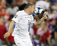 Heath Pearce #2 of the USA goes up for a header with Carlos Costly #13 of Honduras during a CONCACAF Gold Cup match at RFK Stadium on July 8 2009 in Washington D.C.