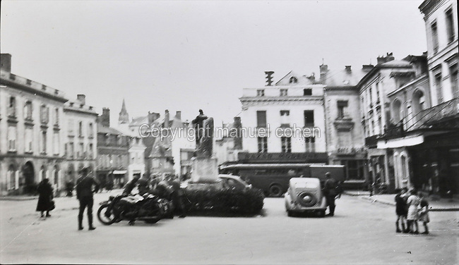 The Place de la Mairie, then known as the Place du Marechal Petain, photograph, c. 1942, during the German occupation of France in the Second World War, in Sable-sur-Sarthe, Pays de la Loire, France. Collection G Cherrier. Picture by Manuel Cohen / Further clearances required