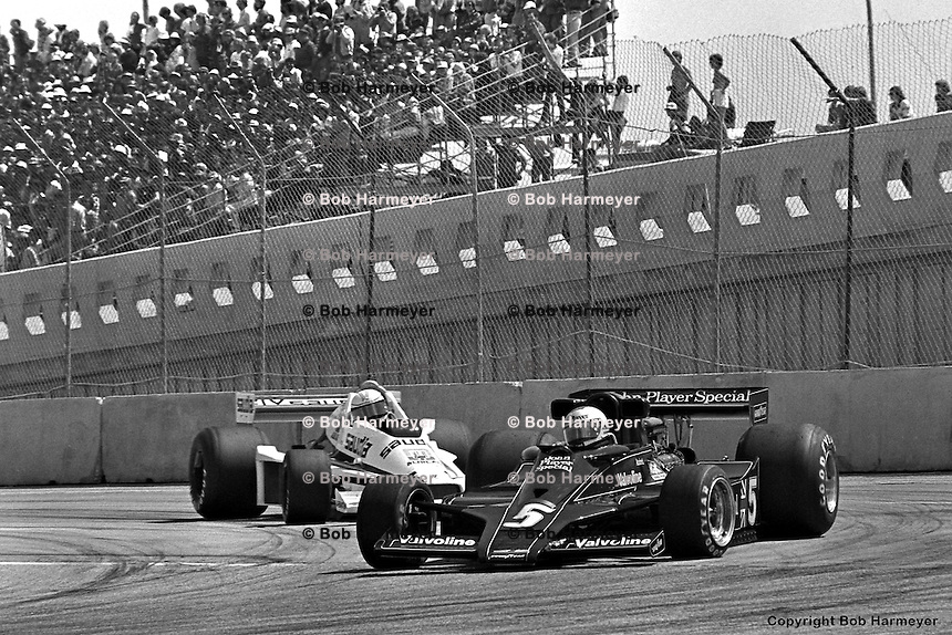 LONG BEACH, CA - APRIL 2: Mario Andretti drives his Lotus 78 R3/Ford Cosworth DFV ahead of Alan Jones in the Williams FW06 002/Ford Cosworth during the United States Grand Prix West on April 2, 1978, at the temporary street circuit in Long Beach, California.
